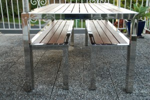 Stainless and timber table setting