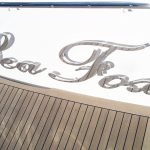 Raised stainless boat name and letters