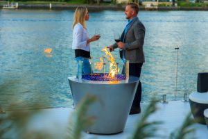 Outdoor entertaining with a round gas fire pit, Australia