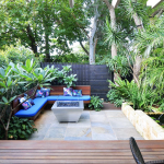 Outhouse Design backyard transformation with gas fire pit