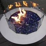 Circle gas fire pit with blue stones