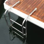 Stainless swim ladder on boat duckboard