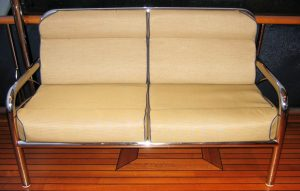 Stainless Steel Furniture, Custom stainless couch with cushions on back of boat