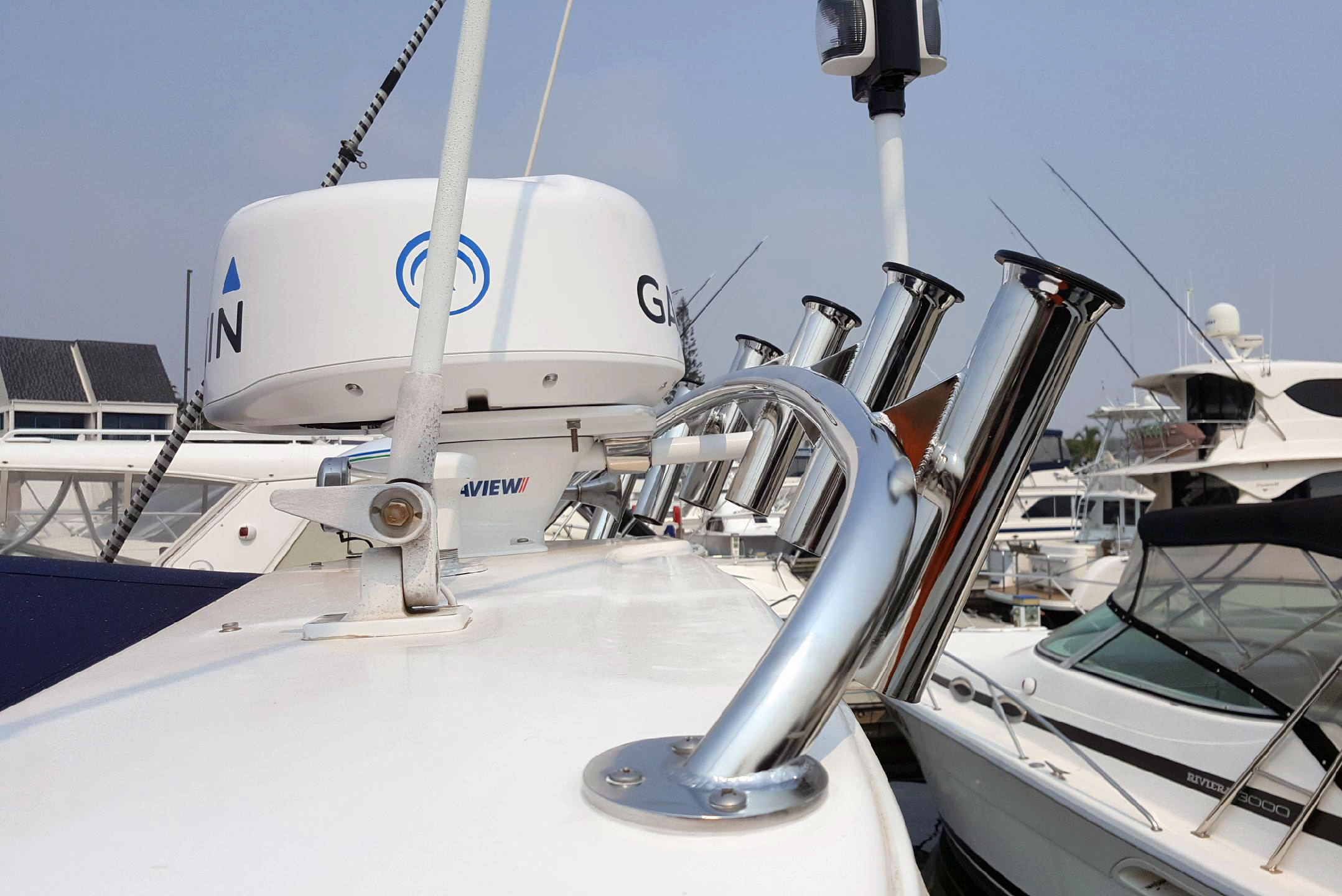 Custom stainless steel rod holder rack on Riviera boat roof
