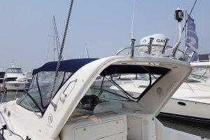 Custom stainless steel rod holder rack on boat roof