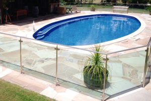 Stainless steel oval pool fencing with tinted glass panels
