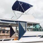 Stainless steel custom boat bimini on Mariner