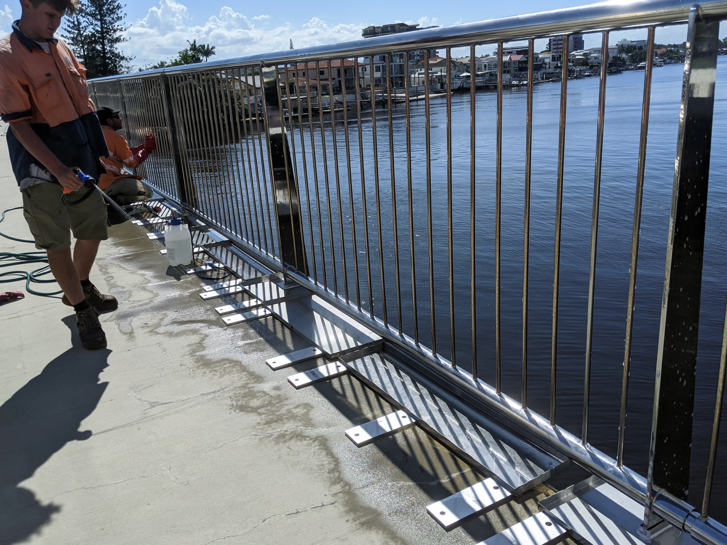 Cleaning outdoor stainless baustrade, Thomas Drive Bridge Surfers Paradise QLD